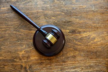 Judge gavel on wooden background, copy space, top view. Law, auction concept