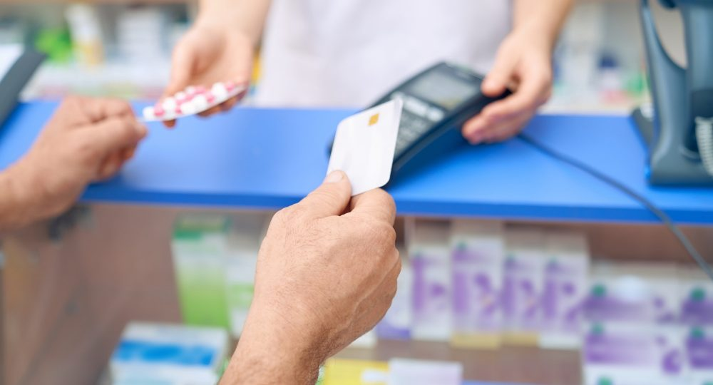Customer paying for pills using credit card