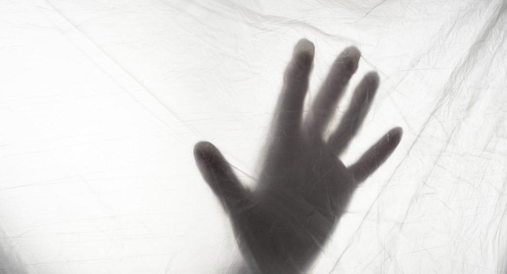 silhouette of a hand of coronavirus covid 19