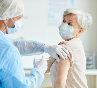 Doctor Giving Covid-19 Vaccine To Woman