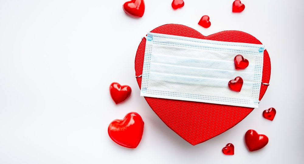 Medical face mask and red heart.