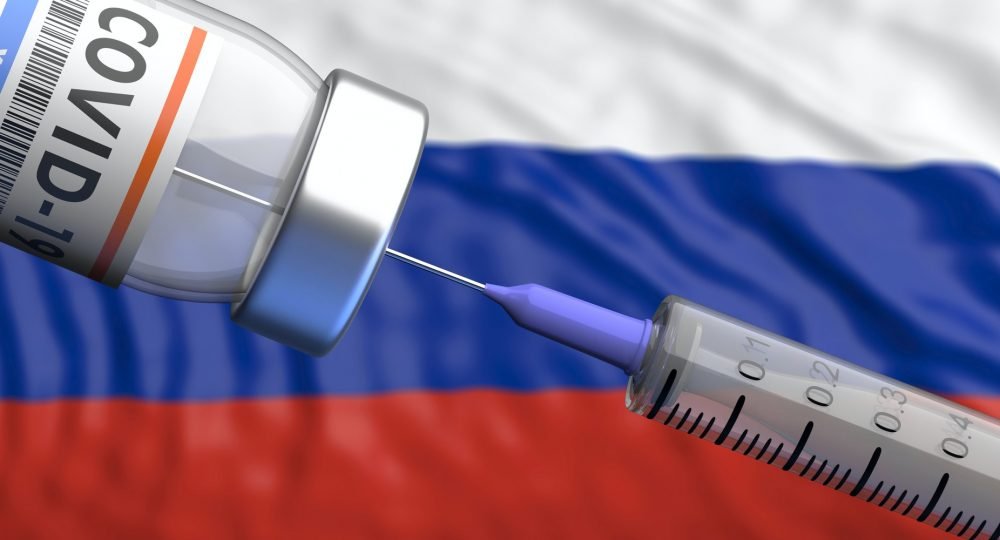 Sputnik V, Russian Coronavirus vaccine. Covid-19 vaccination, russian flag background.