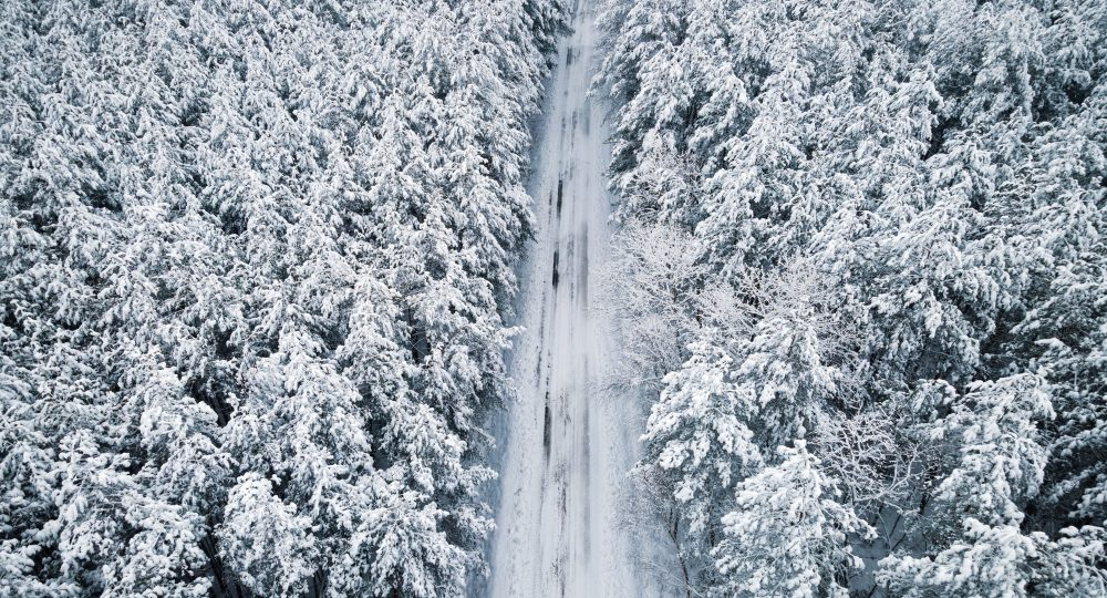 Slippery Dangerous Driving Conditions on the Roads After Heavy Snowfall. Drone View