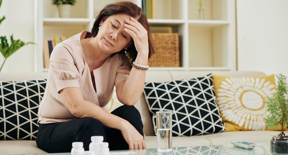 Stressed sick mature woman